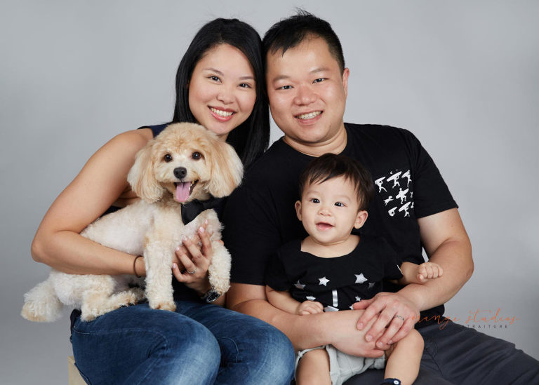 Family Portrait With One Year Old Baby Boy And Pet Dog In Singapore Studio