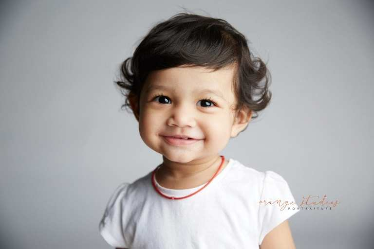 smiling baby portraits in singapore studio
